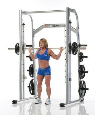 female fitness models doing back squats